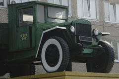Retro lorry truck. Green color, down side. Body, silver exhaust pipe, car wheel.  Royalty Free Stock Photography