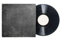 Retro LP vynil record with sleeve. Old vinyl LP record with empty label and grungy cardboard cover on a white background Royalty Free Stock Image