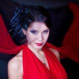 Retro Mädchen in einem roten Kleid Lizenzfreie Stockfotografie