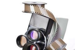 Retro machinalna film kamera i rolka film odizolowywający Fotografia Royalty Free