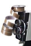 Retro machinalna film kamera i rolka film odizolowywający Obrazy Royalty Free