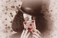 Retro magician holding burnt playing card Royalty Free Stock Photo