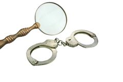 Retro Magnifying Glass and Handcuffs Stock Photography