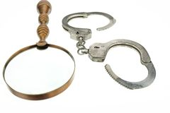 Retro Magnifying Glass and Handcuffs Royalty Free Stock Image