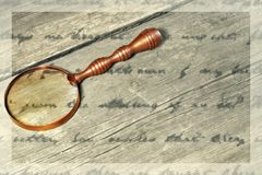 Retro Magnifying Glass and unrecognizable text, XXXL Royalty Free Stock Photography