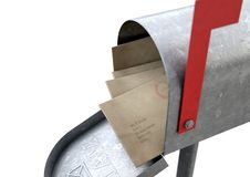 Retro Mail Box And Letter Stack. An open old school retro tin mailbox bulging with a stack of letters and envelopes crammed into it on an isolated background Royalty Free Stock Image