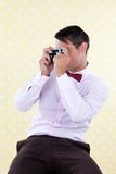 Retro Male with Rangefinder Camera Royalty Free Stock Photography