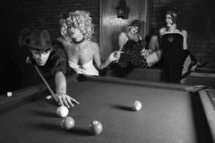 Retro male shooting pool. royalty free stock photos