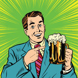 Retro man with a beer pop art Stock Photos