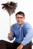 Retro Man with Duster. Portrait of retro male holding feather duster Stock Photography
