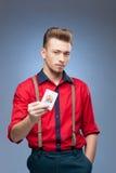 Retro man holding Jocker card Stock Images