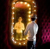 Retro man looks on mirror. Retro young man looks at itself in mirror Royalty Free Stock Photography