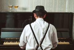 Man playing the piano royalty free stock photo