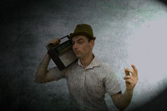 Retro man with radio Royalty Free Stock Images