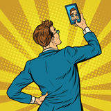 Retro man selfie on smartphone. Pop art retro vector illustration Royalty Free Stock Images