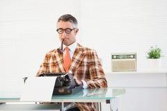 Retro man typing on typewriter Stock Photo