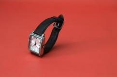 Retro man  wrist watch on red background Stock Photos