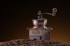 Retro manual coffee mill on coffee Royalty Free Stock Photos