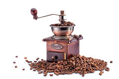 Retro manual coffee mill. On roasted coffee beans isolated Stock Photos