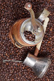 Retro manual coffee mill on roasted beans Royalty Free Stock Image