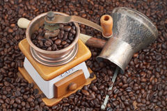 Retro manual coffee mill on roasted beans Stock Image