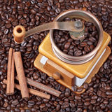 Retro manual coffee mill on roasted beans Royalty Free Stock Images