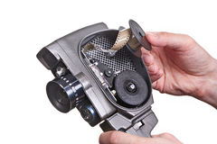 Retro mechanical movie camera with film in hands isolated Stock Images