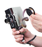Retro mechanical movie camera and film in hands operator isolate Stock Photo