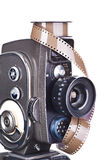 Retro mechanical movie camera and film isolated Royalty Free Stock Image