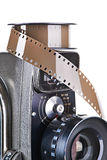 Retro mechanical movie camera and film isolated Royalty Free Stock Photography