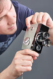 Retro mechanical movie camera in hands of man isolated Stock Image