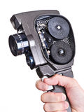 Retro mechanical movie camera in hands of operator with cover op Stock Photography