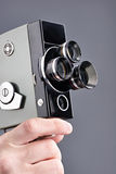 Retro mechanical movie camera in hands of operator isolated Stock Photo