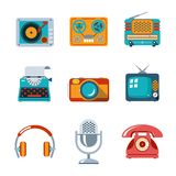 Retro media icons in flat style. TV and microphone, headphones and typewriter and radio Royalty Free Stock Photos