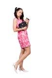 Retro meisje in een roze kleding royalty-vrije stock fotografie