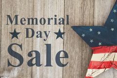 Retro Memorial Day sale message. Memorial Day sale message, USA patriotic old star on a weathered wood background with text Memorial Day Sale Stock Photos