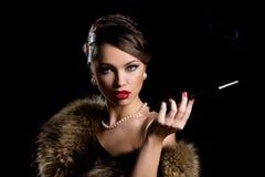 Retro. Menina lindo com cigarro Imagem de Stock