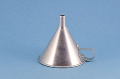 Retro metal funnel hopper tool on blue background Royalty Free Stock Photography
