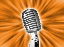 Retro metal microphone over background Stock Photo