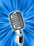 Retro metal microphone over background Stock Images