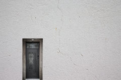Retro metallic door on a light plastered wall Royalty Free Stock Images
