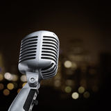 Retro Mic. Vintage Microphone In blur background Stock Images