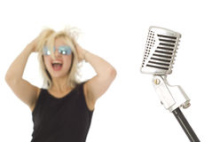 Retro mic and rocking singer Stock Image