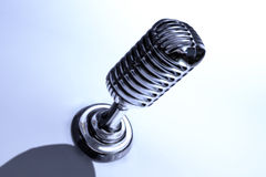 Retro Mic - Vintage Microphone. Close-up on the white background Stock Image
