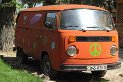 Retro microbus. Hippies. in the sunlight on nature royalty free stock images