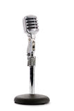 Retro Microphone. Close-up of a retro microphone on a table stand.  Isolated on white Stock Images