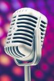Retro microphone. Microphone retro on purple disco background stock photos