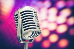 Retro microphone. On purple disco background Stock Photo