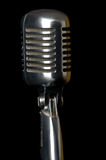 Retro Microphone. Close-up on black background royalty free stock photo