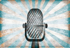 Retro microphone. Against vintage stylized background Stock Photos